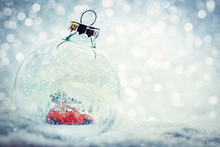 Christmas Glass Ball In Snow With Miniature Winter World Inside