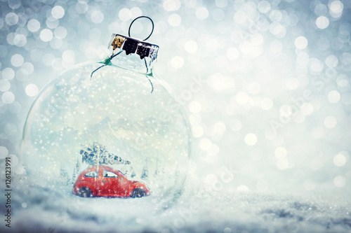 Keuken foto achterwand Vintage cars Christmas glass ball in snow with miniature winter world inside