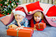 boy and girl give Christmas gift