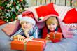boy and girl give Christmas gift