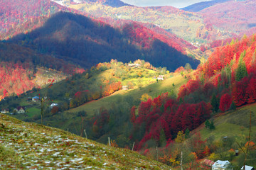 Obraz na Plexi First snow fall in the Carpathian village