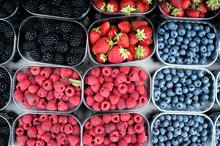 Strawberries, Cherries, Raspberries And Blackberries In The Local Market.
