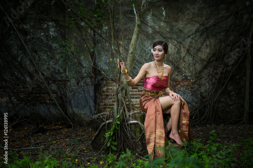Valokuva  Asian woman wearing dress traditional Thai costume ,beautiful women thai in the past