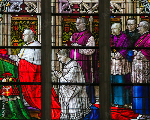 Foto op Aluminium Imagination Cardinal kneeling - Stained Glass in Mechelen Cathedral