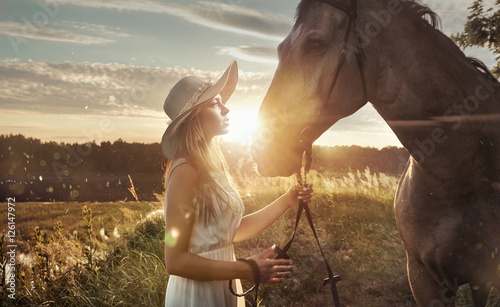 Printed kitchen splashbacks Artist KB Cheerful, attractive woman with a majestic horse