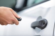 Man Locking Car Door Using Remote Control Key Fob