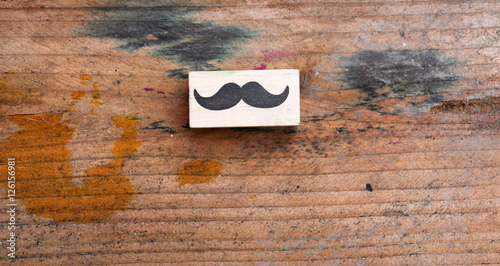 Photo  moustaches rubber stamp. Movember men's health awareness concept.