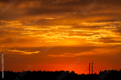 Foto op Canvas Baksteen Bright vibrant orange and yellow colors sunset sky
