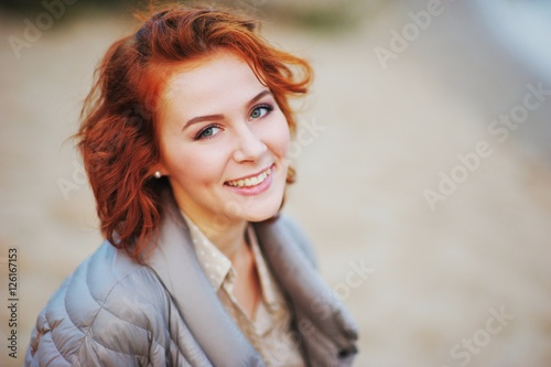 Valokuva  A wonderful portrait of a young pretty girl with beautiful eyes and charming smile, outdoor, closeup