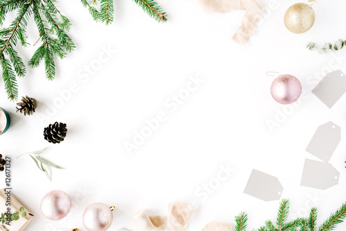 Fototapety, obrazy: Christmas composition. Frame with fir branches, pine cones, christmas balls, ribbon and tinsel. Flat lay, top view