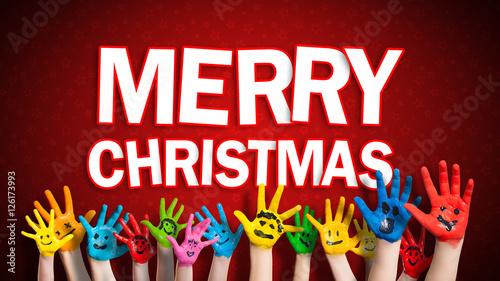 viele angemalte Kinderhände mit Smileys vor weihnachtlichem ...