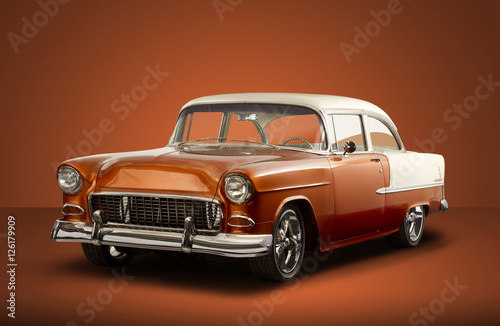 Obraz Vintage 1955 Chevrolet Bel Air - Orange Background - fototapety do salonu