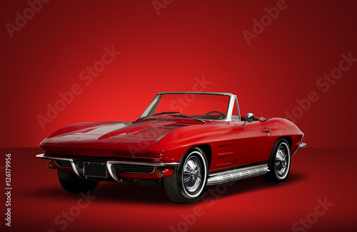 Fotografie, Obraz  Red Vintage Convertible Automobile on Red Background