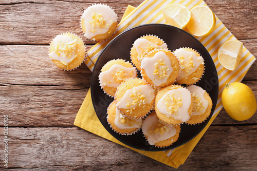 Stampa su Tela Homemade lemon muffins sprinkled with zest close-up on a plate