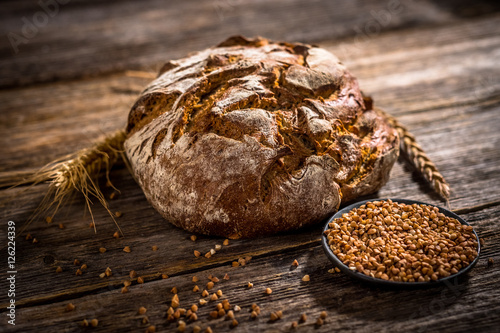 Canvas Prints Bread Freshly baked bread on rustic wooden background