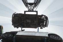 Forklift Hoisting Car Wrecks At The Junkyard
