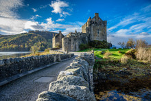 Majestic Eilean Donan Castle On Beautiful Autumn Day - With Sunny Foreground, Dramatic Sky And Amazing Scenery