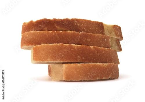 Fotografie, Obraz  Stacked sliced bread on a white background