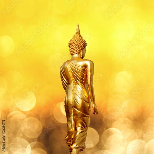 Foto op Plexiglas Indonesië Golden buddha statue from Wat Khao Noi in Nan Thailand under dreamy bokeh background