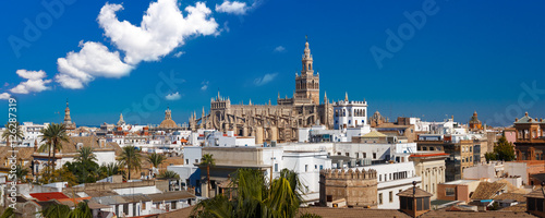 Panorama of Famous Bell Tower named Giralda in landmark catholic Cathedral Saint Mary of the See, aerial view from the Torre Del Oro, Seville, Andalusia, Spain