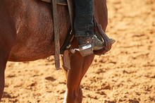 Close-up Of A Spur Og The Horserider Sitting On The Horse With Cowboy Boot