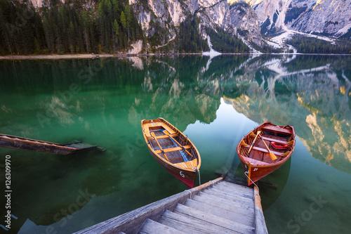 Fotobehang Meer / Vijver Boats on the Braies Lake ( Pragser Wildsee ) in Dolomites mounta