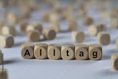Leinwand Poster  Alltag - Holzwürfel mit Buchstaben