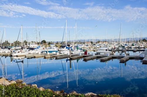 Boats dock and marina with reflection at harbor in Oxnard, California