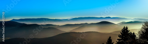 Foto auf AluDibond Blau Aerial view of colorful autumnal mountains, foggy sunset