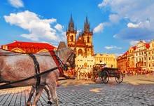 Prague, Classical View On Central Square With White Horses On Foreground. Czech Republic.