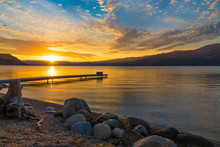 Okanagan At Sunrise With Rocks In The Foreground