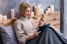 Delighted Woman Shopping Online In Bed