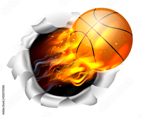 Photo  Flaming Basketball Ball Tearing a Hole in the Background
