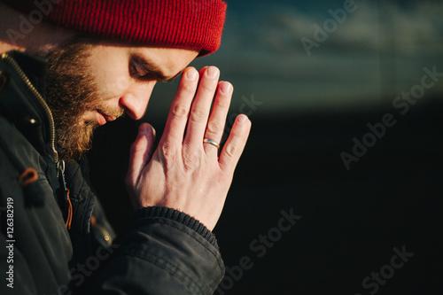 Fotografija Man praying outside to God