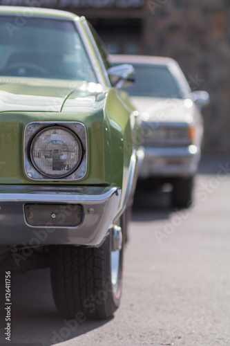 Close-up of an old car. Part of the exterior. An American classic. Chrome lining. Glass with reflection. © zhdanovdi