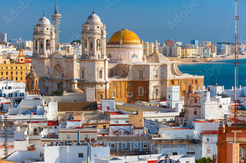Aerial view of the old city rooftops and Cathedral de Santa Cruz in the morning from tower Tavira in Cadiz, Andalusia, Spain