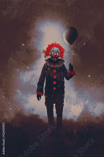Photo  evil clown standing with a black balloon against a dark background,illustration