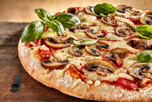 Fresh Basil On Top Of Cheese And Mushroom Pizza