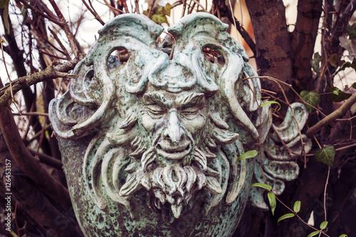 Obraz na plátně Satyr Woodland god face sculpture