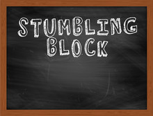 STUMBLING BLOCK Handwritten Text On Black Chalkboard