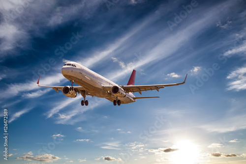 Fotografie, Obraz  Airplane with beautiful sky on background