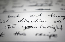 """Lyrics Written On Paper In Black Ink Close Up. Focus On The Word """"direction"""" And """"I'm Goin In"""""""