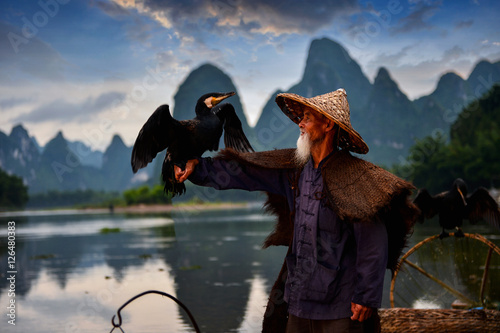 Photo Stands Guilin Fisherman of Guilin, Li River and Karst mountains during the blue hour of dawn,Guangxi China