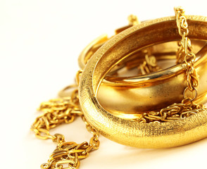 Gold jewelry, bracelets and...