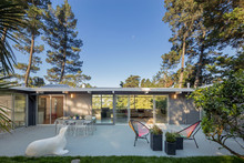Mid Century Modern Home With Open Floorplan And Outdoor Furnitur