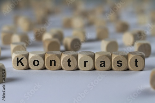 Fotografie, Obraz  Kontrast - Holzwürfel mit Buchstaben