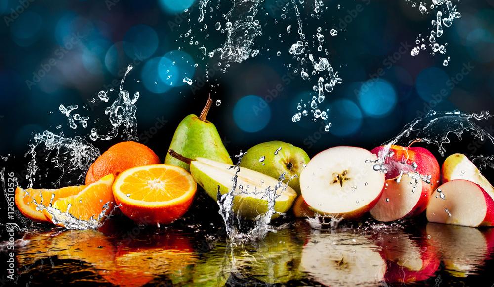 Fototapeta Pears, apples, orange  fruits and Splashing water