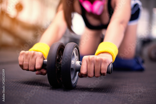Fototapeta  Close up hand,beautiful young women doing pilate exercises in fitness studio,bea