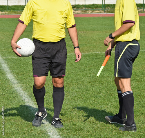 Fotografiet  Two soccer referee before match