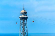 Red Cable Car Over Barceloneta Beach On Blue Sky Background, Barcelona, Spain